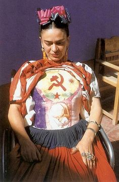Frida Kahlo body cast painting ...by adding the communist symbol to her chest she could show her political heart and force her true identity into the faces of photographers and american magazines who kept trying to press her into the shape of a mexican novelty who was only interesting because of her fashion style