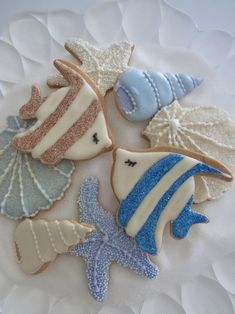 Angelfish or Damselfish, cone & scallop shells, sea star decorated cookies