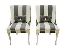 Wide grey and white striped chairs with yellow piping. These would be just perfect for my bedroom. Well except for the price tag...
