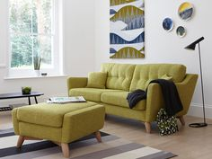 The large Cosenza sofa is the ideal centrepiece for any room, with eye-catching retro style, button back cushions and show oak wood legs giving that classic ercol touch.