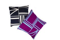 """ON THE EDGE Emily Diamandis looked to the boldly delineated shapes of 1950s geometric paintings for the Owami cushion, a new addition to her Tabula Rasa collection of home accessories. The 20"""" sq. jacquard-knit pillow comes in Navy, left, and Bright Purple, and costs $200. tabularasa-ny.com"""