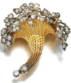 Gold, seed pearl and diamond brooch/pendant, Late 19th Century. Designed as a cornucopia, set with a seed pearl, circular-, single-cut and rose diamonds, detachable brooch fitting.