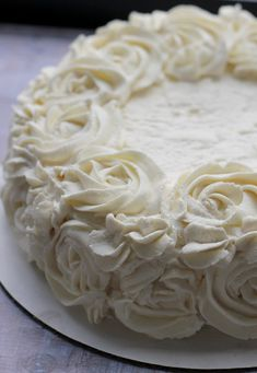 Vanilla Cloud Cake - an angel food cake with a rich vanilla flavor covered in a whipped cream cheese frosting! #dessert #cake