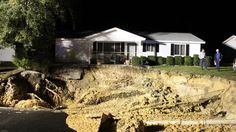 A massive 60-by-50-foot sinkhole 15 feet deep that opened up overnight in Ocala, Florida, is threatening to swallow homes in the town's Oak Run neighborhood.