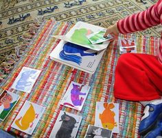 Take a picture of book pages, laminate, and let toddler match picture to book pages