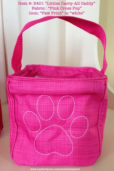 "The ""Littles Carry-All Caddy"" in ""pink cross pop"" with ADORABLE paw print icon-it in white."
