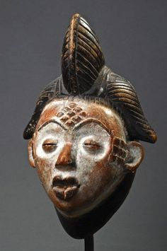 Africa | Mask from the Punu people of Gabon | Wood | Image ©Michel Renaudeau