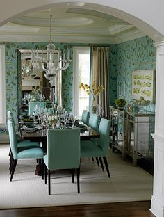 Placing a mirror at the head of the table in a dining room can create the effect of another window while providing a dramatic reflection of adjoining rooms.