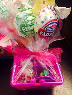 My daughter's party favors for her Shopkins birthday party. Candy, bag, basket, bottle cap necklace, & Dippy Avocado Shopkins.