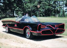 The Batmobile from the 1966–1968 live action television show and its film adaptation began life as a Ford concept car called the Lincoln Futura, built over a decade earlier in 1955. The body of the Futura was fabricated by Ghia of Italy, whose artisans hammered the car's panels over logs and tree stumps carved as forms to create the sleek manta ray-like car. In 1959, the Futura was featured sporting a fresh red paint job in the film It Started With A Kiss, starring Debbie Reynolds and…