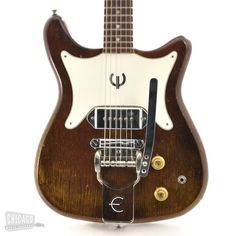 Here is an asbolute steal of a price on an incredible Epiphone Coronet from 1965. This guitar was originally Cherry, but the finish has faded to a striking brown over the years that only enhances it's totally vintage attitude. We've had this guitar for a little while here at the Chicago Music Exchange, and in an effort to clear some space, we're moving this one at an unprecedented low price. This is your chance to add an authentic vintage axe with a style and sound all its own to your…