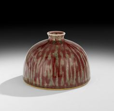 "Chinese Peachbloom Beehive Water Pot 19th century, the porcelain bottle with a mottled green and brownish-red glaze, a two-column six-character Yongzheng reign (1723-1735) mark on the underside in underglaze blue, h. 3-7/8"", dia. 5-1/2""."