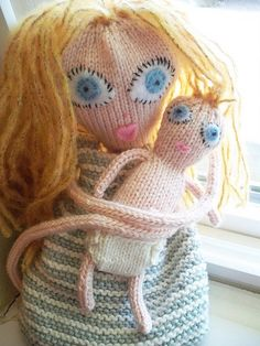 "cute knitted baby, diaper and blanket styled after the dolls in the book ""Knitted Babes"" by Claire Garland - free pattern"