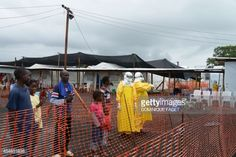 News Photo : Health workers wear on September 7, 2014...