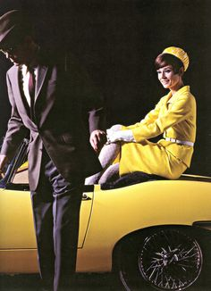 """The actor Peter O'Toole photographed with the actress Audrey Hepburn (in a Jaguar XKE convertible, painted in yellow.) by Douglas Kirkland at the Studio de Boulogne in Paris (France), for the publicity of their new film """"How to Steal a Million"""", in November 1965. She is wearing Givenchy"""