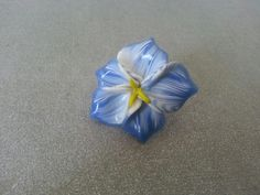 White and blue flower ring on a silver plated base