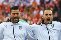Graziano Pelle (L) and Daniele De Rossi (R) of Italy sing the national anthem prior to the UEFA EURO 2016 Group E match between Belgium and Italy at Stade des Lumieres on June 13, 2016 in Lyon, France.