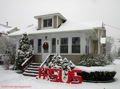 """""""Jesus"""" sign on snow in front of a Morton Grove, Illinois Chicago-style bungalow for Christmas"""