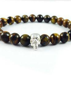 Dizarro to męska biżuteria najwyższej jakości produkowana z kamieni półszlachetnych, srebra, złota oraz kryształów Swarovski™.  Bransoletka wykonana z kamieni tygrysiego oka oraz czaszki ze srebra wysokiej próby 925.Szczegóły:- czaszka ze srebra 925- bransoletka wkładana na elastycznej gumce- średnica kulek: 8 mm- bransoletka zapakowana w eleganckie, czarne pudełko