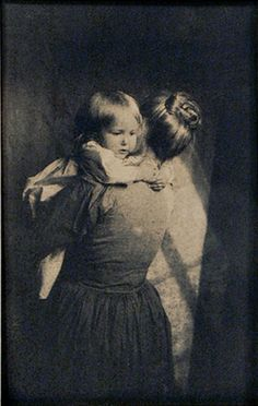 """liquidnight:    """"Mothers arms are made of tenderness, and sweet sleep blesses the child who lies within.""""  —Victor Hugo, Les Miserables  Pictorialist Style Mother Holding Child, Platinum print, circa 1915  [Photo from the Rodger Kingston Collection]"""