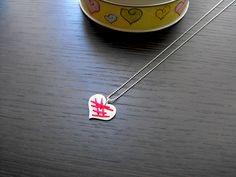 Colar de coração em prata 950 com detalhe de linha vermelha R$90,00