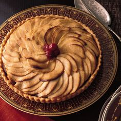 Apple Tart with Bananas and Cranberries | Chefs Eric Bromberg and Bruce Bromberg developed this holiday version of a traditional apple pie, with added rum and dried cranberries.