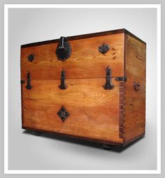 KOREAN BANDAJI - this is actually a blanket chest.  The front top panel opens down and the blankets can be put away easily without disturbing whatever is displayed on the top.  The top is usually made of one large piece of precious wood, which might be different from the sides.  Inside will be lined with paper on top of a fragrant wood. Note the handles on the side.