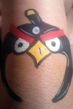 Black Angry Bird Mask Face Painting Design - Hire a facepainter to transform your guests into movie characters. - Movie night tip by Southern Outdoor Cinema