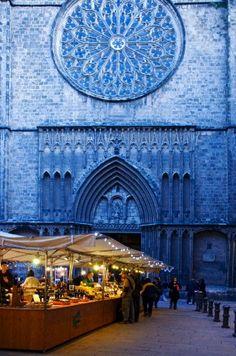 Christmas delicatessen market on Placa del Pi and Esglesia del Pi (Church of the Pi), Barri Gotic. Barcelona. Catalonia