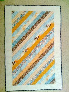On diagonal this boring quilt is much more effective