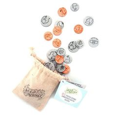 Seed Money! These letterpress printed paper coins are embedded with real live seeds. Tuck them in soil, give 'em some water, and watch your investment grow. Thirty piece pack! •Pennies = delicate wildflowers •Nickels = spritely herbs •Dimes = crunchy root crops •Quarters = crispy fresh salad greens