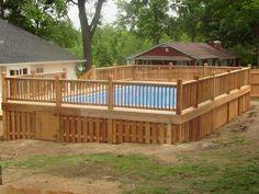 Cedar deck built around an above ground pool with shadow-box skirting; built by DW Elite Decks in Shawnee, Kansas.
