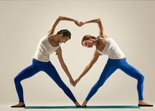 Yoga in pair. heart Royalty Free Stock Image