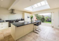 Open plan kitchen traditional lantern, bi-fold doors, stone flooring and central island How To Plan, Stone Flooring, Bifold Doors, Open Plan Kitchen, Kitchen, Open Plan Kitchen Diner, Traditional Lanterns, Kitchen Living, Kitchen Extension