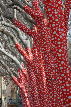 Tree art in France -- Ascension of Polka Dots on Trees - Yayoi Kusama