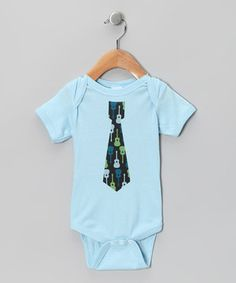 "Made for the coolest of kiddos and parents passing on their great taste, this dapper bodysuit puts the ""rock"" in ""Rock-a-bye Baby."" Its super-hip graphic is perfect for showing off on special outings. Even better, its cozy cotton construction feels and looks awesome while dancing—or crawling—around the living room."
