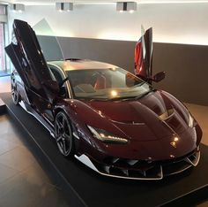 Lamborghini Centenario Coupe made out of exposed Dark Red carbon fiber w/ Bianco accents and polished wheels w/ Red carbon fiber blades Photo taken by: @hongkongcars on Instagram