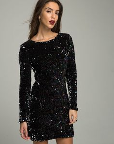An update to the LBD, this dress come in a dazzling iridescent oil sequin. Be star of the show in an ultra flattering bodycon fit, long sleeves and sultry V neck back.