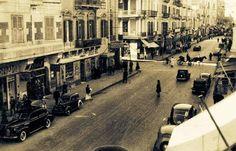 """صورة جميلة لأحد شوارع الاسكندرية """"  شارع سعد زغلول مع تقاطع النبي دانيال تقريبا """" عام 1940 م تقريبا"""