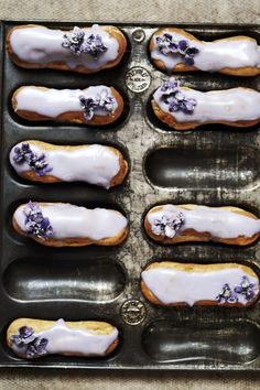 violet and lemon eclairs . { how ridiculously pretty do these eclairs look . with a violet & lemon twist . the Great British Bake Off 2015 . Eclairs, Köstliche Desserts, Delicious Desserts, Dessert Recipes, Yummy Food, French Desserts, Plated Desserts, Yummy Treats, Sweet Treats