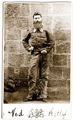 The last photos of Ned Kelly were taken by the official Melbourne Gaol photographer, Charles Nettleton on November 10, 1880, the day before Ned's execution. In this full-length study, Ned holds the cord attached to his leg irons to disguise the withering of his wounded left arm and rests a fist on his hip to mask a crippled hand.