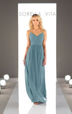 Sweet spaghetti straps give this romantic, chiffon bridesmaid dress a flirty touch. It's v-neck bodice features ruching, and the lightweight skirt falls into a floor length. This style is also available in cocktail length as Style 8745.