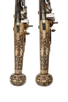 A RARE PAIR OF SMALL SOUTH GERMAN WHEEL LOCK PUFFERS FOR A BOY, SAXON, dated 1586 Size: Length 29.5 cm /11.6 inches