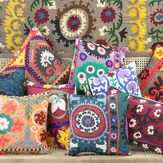 Supple Suzanis from Uzbekistan. Just love these colors and mixed patterns thrown together.