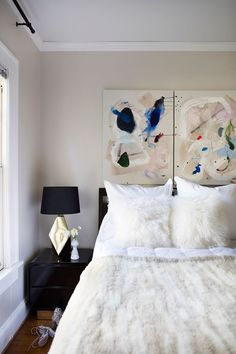 Chic bedroom with graphic artwork and a fur throw