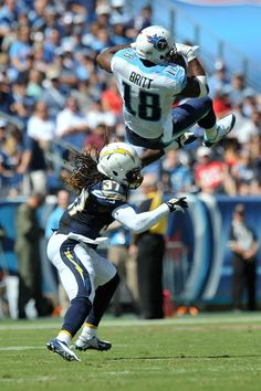 Kenny Britt-WR (18) for the Tennessee Titans leaps to catch a pass against San Diego Chargers defensive back Jahleel Addae (37).  Tennessee won 20-17, 09/22/13