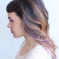 Lavender and peach highlights and baby bangs. Love this hair!