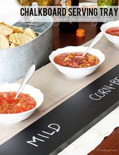 PIN FOR LATER -- You have to try this genius chalkboard serving tray for your next party. The best part is you can reuse and decorate this for different parties and food - how cool!