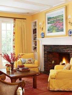 Yellow walls, white millwork, fireplace, honey wood floors, plush twin chairs, red floral accents;  OK, THIS is my dream room!!!