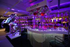 Kehoe Designs' eye-catching booth had an oversize stallion statue, a curvy, mirrored bar, disco balls, and color-changing light.